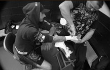 Scott Rehm wrapping Bobby Flynn's hands before a mma fight