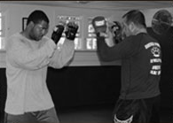 Scott Rehm training a student in boxing