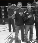 Tim Burrill and Matt Phinney standing on the Tapout banner